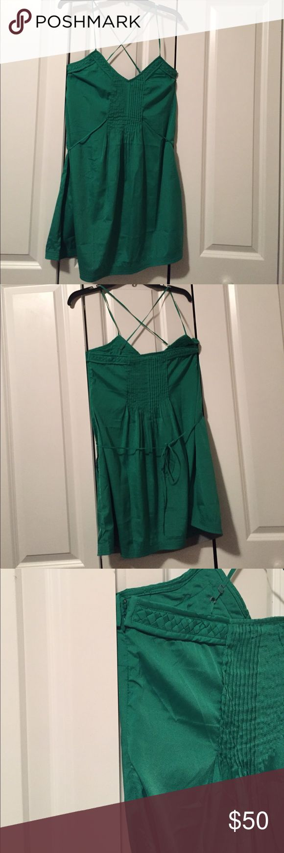 Like new Kelly green dress Like new- maybe worn once or twice. Has the thin straps and in the back they to cross cross. Fits like a babydoll dress because it ties in the back as well. Has side zipper. Originally purchased at urban outfitters. All pictured. Ecote Dresses Mini