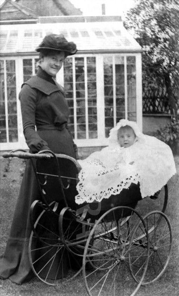 Antique photo of mother with baby in pram, on a farm near Gloucester, England, 1900 - 1910.