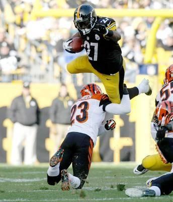 Pittsburgh Steelers running back Jonathan Dwyer (27) leaps over Cincinnati Bengals cornerback Terence Newman (23).