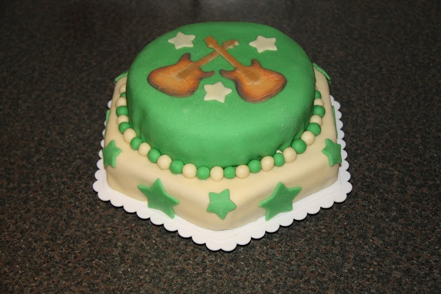 Marzipan covered vanilla cake with Sunburst guitars for my sons 9th birthday