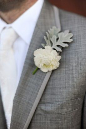 Love the way the white ranunculus is facing down in this boutonniere accented with dusty miller.