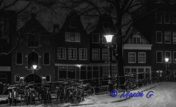 amsterdam snow canals nightphotography winter bikes jordaan
