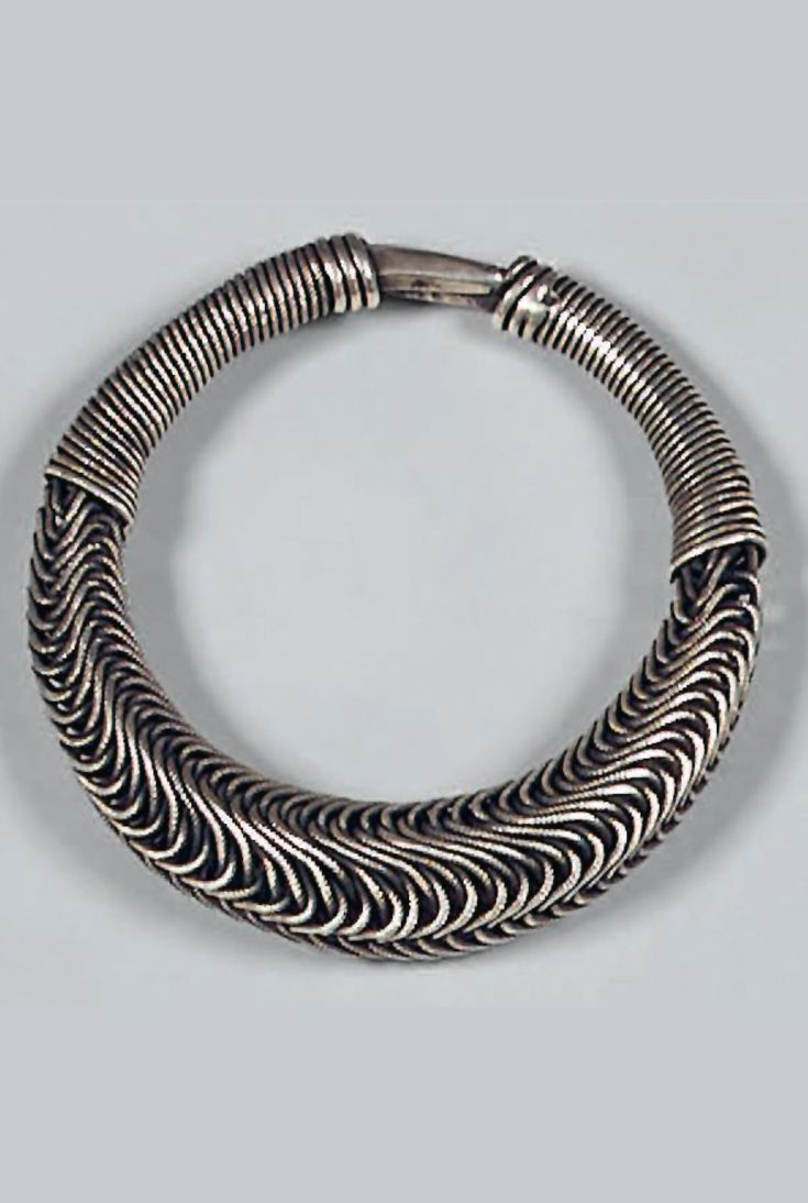 Southern China   Girl's bracelet from the Miao people; silver. Ø 9 cm. 86 grs   Est. 1'000 - 1'200€ ~ (Dec '14)