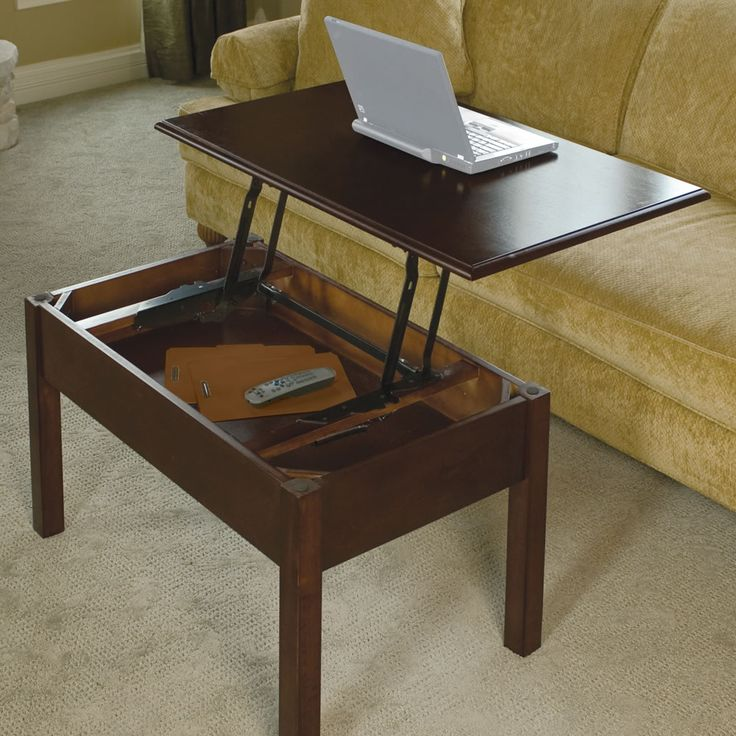 The Convertible Coffee Table - Hammacher Schlemme.  I know a little boy who can build this for his mama.  Jeff will u build me one. PLEASE, please, lol.