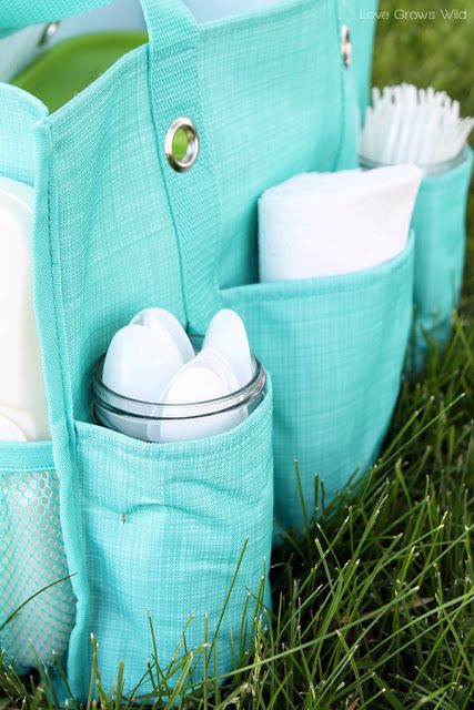 Mason jars fit in the pockets of the thirty one organizing utility tote for holding picnic supplies!this is a cute picnic idea!! Or for exploring in the mountains
