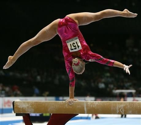 Hungary's Dorina Boczogo competes on the balance beam during a qualification session at the Artistic Gymnastics World Championships in Antwerp, Belgium, Tuesday, Oct. 1, 2013. (AP Photo/Virginia Mayo) ▼2Oct2013AP|US champion Biles takes lead in worlds qualifying http://bigstory.ap.org/article/us-champion-biles-takes-lead-worlds-qualifying #Dorina_Boczogo #Balance_beam