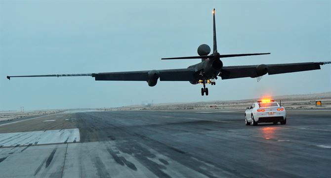 A mobile chase car driver pursues a U-2S reconnaissance aircraft during its landing at an undisclosed location in Southwest Asia, Dec. 7, 2015. Mobile chase car drivers act as a second pair of eyes and ears for U-2S pilots during their launch and landing - RAF Fairford