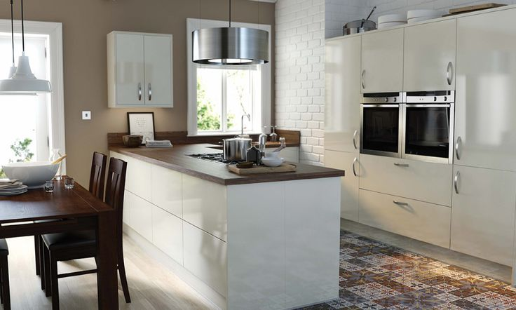 Wren Kitchens: Pacrylic Cream Gloss Kitchen - Accessorise with wooden statements and earthy tones for something a little more country inspired. Stainless steel appliances keep the contemporary edge for on-trend kitchen style.
