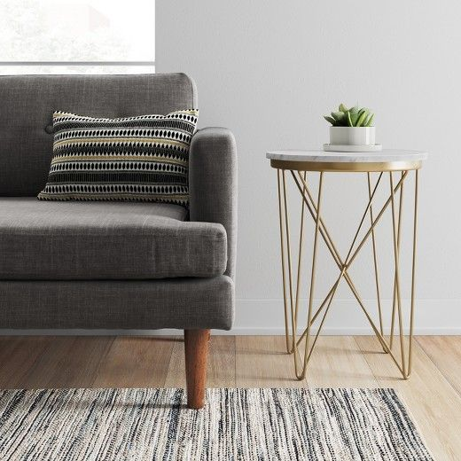 Add a touch of class and mid-century modern style to your space with this Marble Top Round Table from Project 62™. The criss-cross steel legs add dimension to your space while the marble top brings classic style. This small end table is the perfect height for a sofa end table or a plant stand. <br><br>1962 was a big year. Modernist design hit its peak and moved into homes across the country. And in Minnesota, Target was born - with the revolutionary idea to celebrate desi...