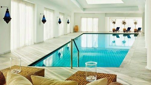 Exquisite Indoor Swimming Pool Design Idea with marvelous White Interior Design