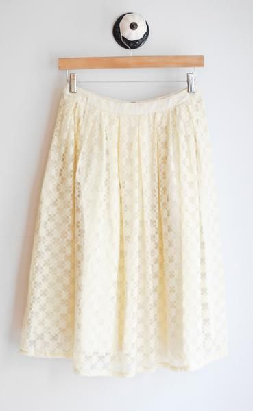 Cream high waisted lace skirt with pleating. Fully lined. Back zipper. 92% Rayon, 8% Spandex Handwash or dry clean recommended