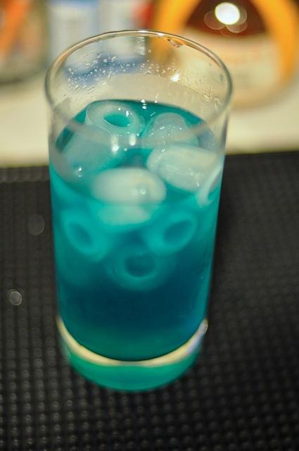 Blue Motherfucker  3 oz Absolut® Citron vodka  3 oz Blue Curacao liqueur  3 oz sweet and sour mix