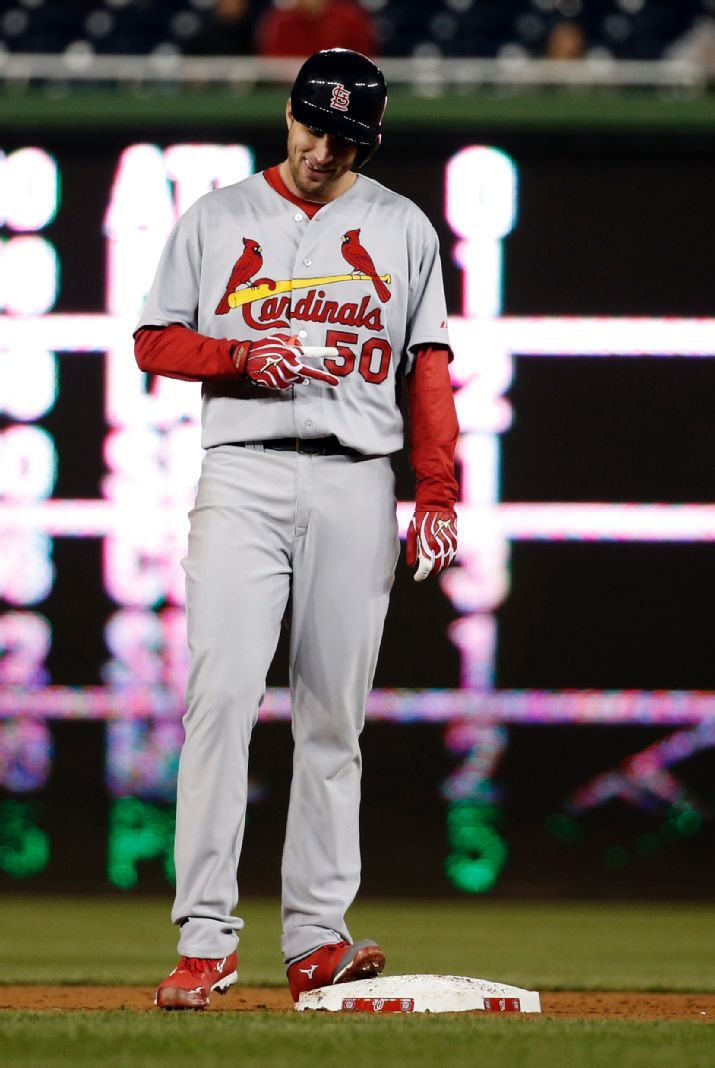 starting pitcher Adam Wainwright holds up two fingers as he stands on second base after hitting a double during the ninth inning of a baseball game against the Washington Nationals. Cards won 8-0.  4-17-14