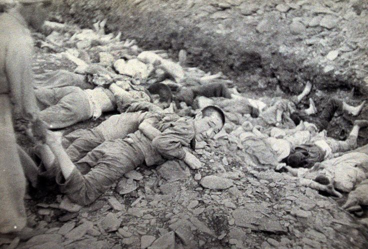 """This U.S. Army photograph, once classified """"top secret"""", is one of a series depicting the summary execution of 1,800 South Korean political prisoners by the South Korean military at Taejon, South Korea, over three days in July 1950. Historians and survivors claim South Korean troops executed many civilians behind frontlines as U.N. forces retreated before the North Korean army in mid-1950, on suspicion that they were communist sympathizers and might collaborate with the advancing enemy."""