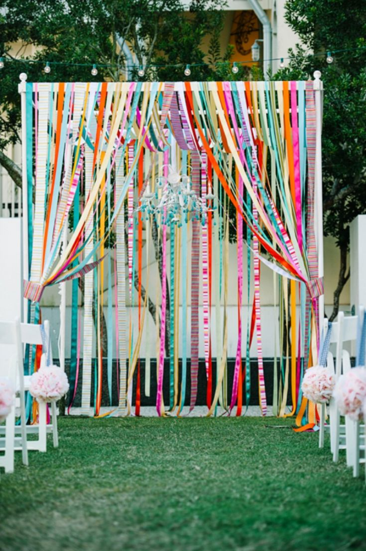 LOVE this colorful ribbon. This would be cool for a cake-space. Build a simple frame out of PVC pipe (anchored in with re-bar), or use a shade canopy (frame only?) and re-do it somehow. Prep and store before hand. photo by dearwesleyann.com