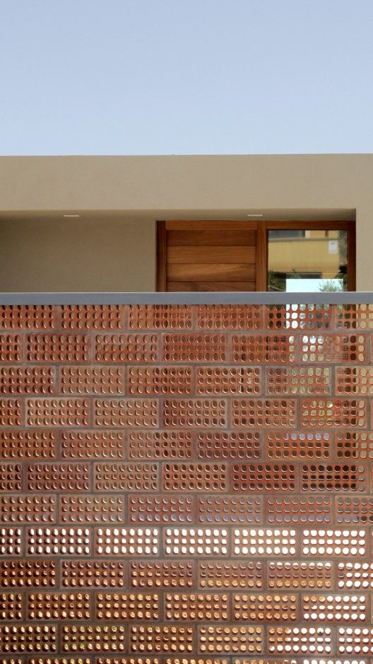 Casa Para Pau & Rocío by Arnau Tiñena Architecture #brick #perforation #fence