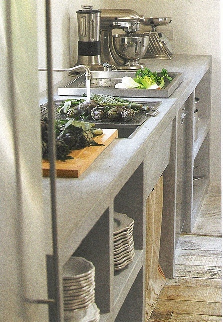love the cement/stone in the kitchen