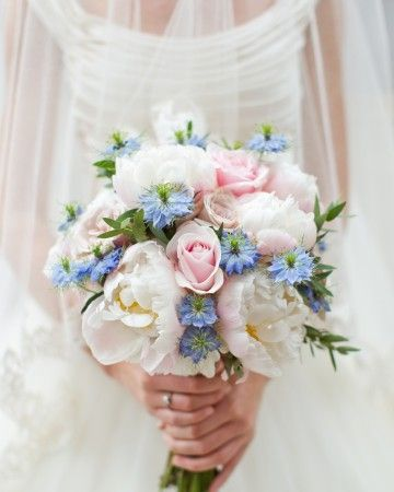Hayley's bouquet, by Flowers by Passion, showcased two varieties of roses (sweet avalanche and quicksand), hydrangeas, peonies, and for a pop of blue, nigellas.
