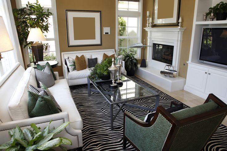 Living room design with two white sofas taupe walls and zebra area rug.