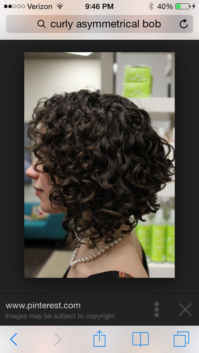 Asymetrical bob on curly hair! I love it, but I think I would like it longer. Not quite this short