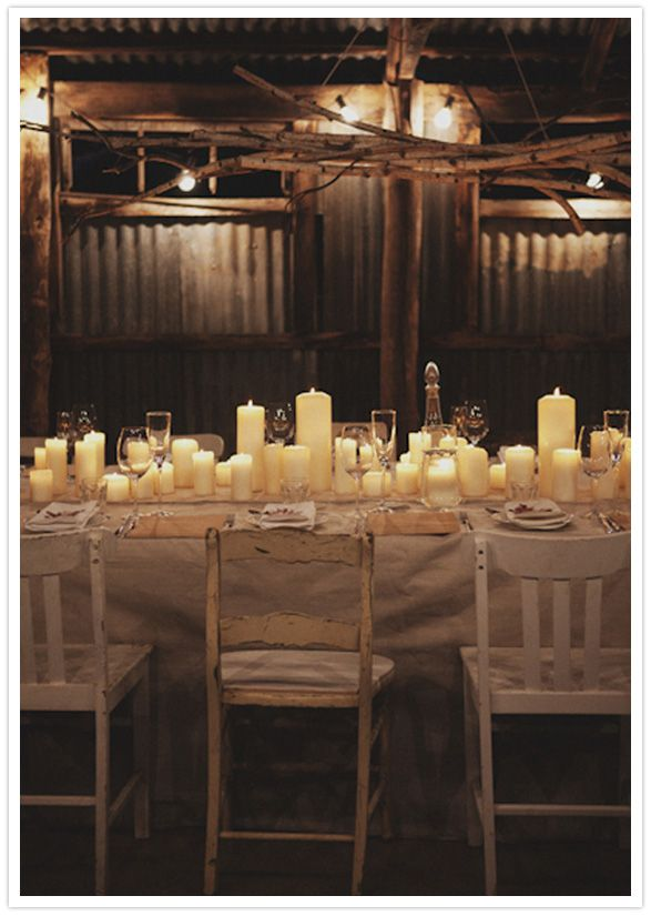 rustic: candles, mismatched wooden chairs, tree limbs, crystal. Throw some burlap in there and we'll be set!