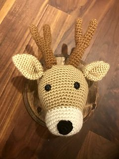 This Amigurumi Crochet pattern is for a Deer Taxidermy style head with antlers. The pattern suggests how you can mount onto a plaque, but how you do that is up to you. The finished product (not including plaque) measures approximately 8.5 inches in length and 7 inches in width.