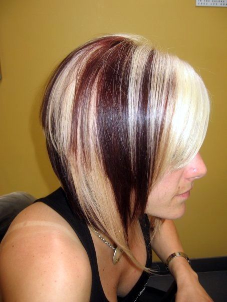 Angled reddish brown bob with platinum streaks
