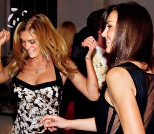 Kate Middleton dancing with Chelsy Davy at the wedding of Peter Philips and Autumn Kelley's wedding at St. George's Chapel in Windsor, May 17, 2008.