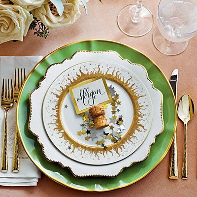 Add instant whimsy with a dash of confetti at each place setting, sprinkled atop a mix of goldtrimmed china. Create a slit in the top of a Champagne cork for an instant, clever placecard holder.