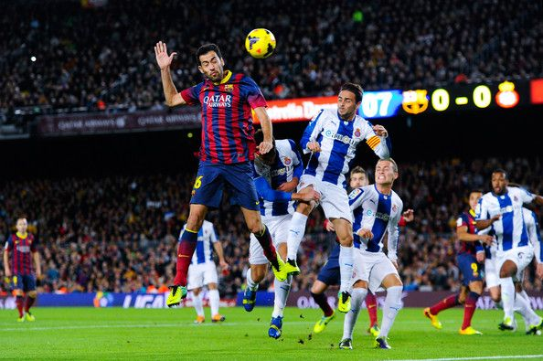 Sergio Busquets of FC Barcelona duels for a high ball with Sergio Garcia of RCD Espanyol during the La Liga match between FC Barcelona and RCD Espanyol at Camp Nou on November 1, 2013 in Barcelona, Catalonia.