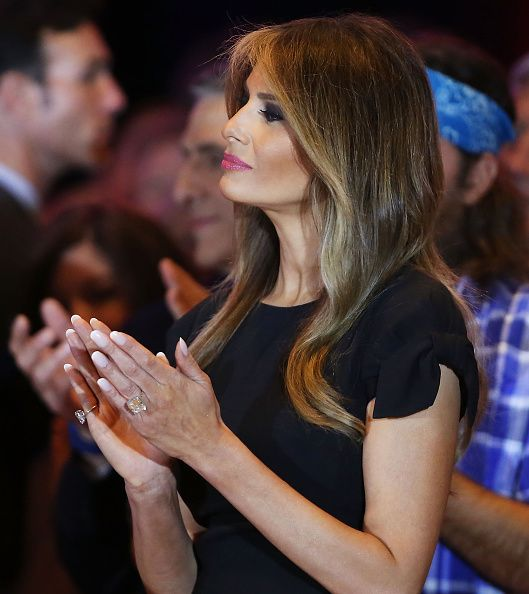 Melania Trump watches as her husband Republican presidential candidate Donald Trump speaks to supporters and the media at Trump Towers following the...