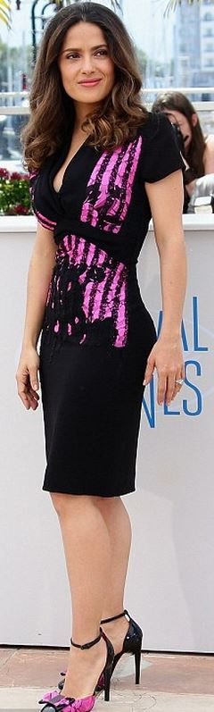 Who made Salma Hayek's pink stripe dress and black bow pumps that she wore in Cannes?