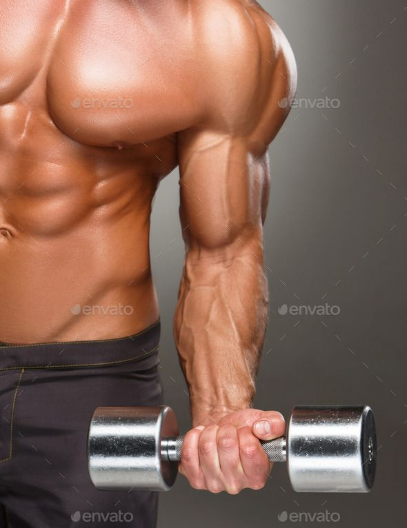 Closeup of a handsome power athletic man bodybuilder doing exercises with dumbbell #fitness #inspiration #bodybuilding
