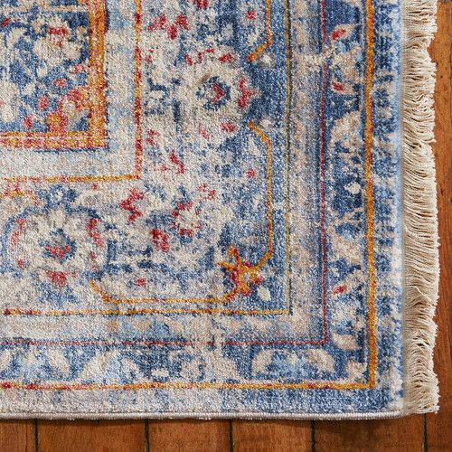 Features:  -Vintage Persian collection.  -Material: Polyester.  Product Type: -Area Rug.  Border: -Yes.  Border Color: -Blue; Multi.  Technique: -Power Loom.  Primary Color: -Blue/Orange/Ivory.  Mater