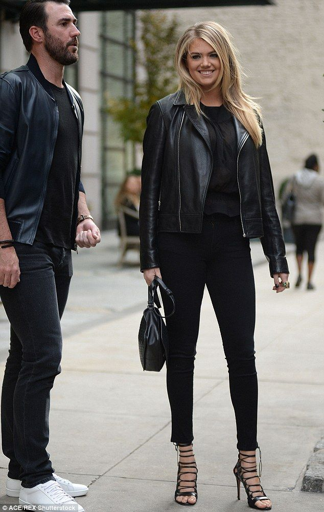 Casually chic: For her NYC adventure, the Sports Illustrated model wore a pair of tight jeans with a high necked silk blouse under a leather motorcycle jacket