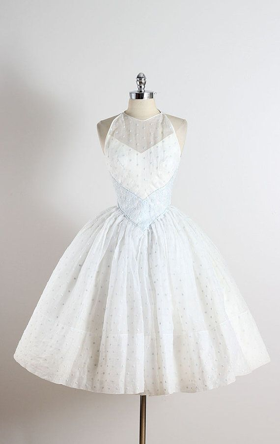 ➳ vintage 1950s dress * gorgeous white organza * acetate lining * ice blue floral & polka-dot embroidery * halter neckline * metal back zipper condition   excellent fits like xs length 44 bodice 18 bust 33 waist 22  ➳ shop http://www.etsy.com/shop/millstreetvintage?ref=si_shop  ➳ shop policies http://www.etsy.com/shop/millstreetvintage/policy  twitter   MillStVintage facebook   millstreetvintage instagram   millstreetvintage  5038/1541