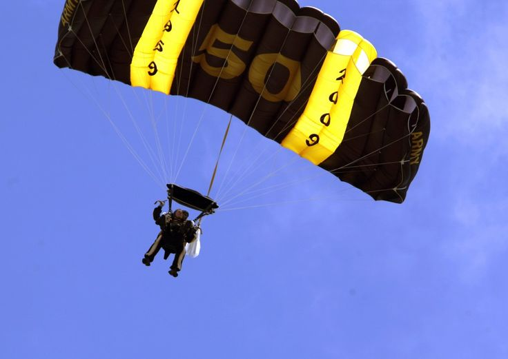 Carrier namesake Pres. Goerge H. W. Bush shows off his youthful side by jumping out of a plane on his birthday
