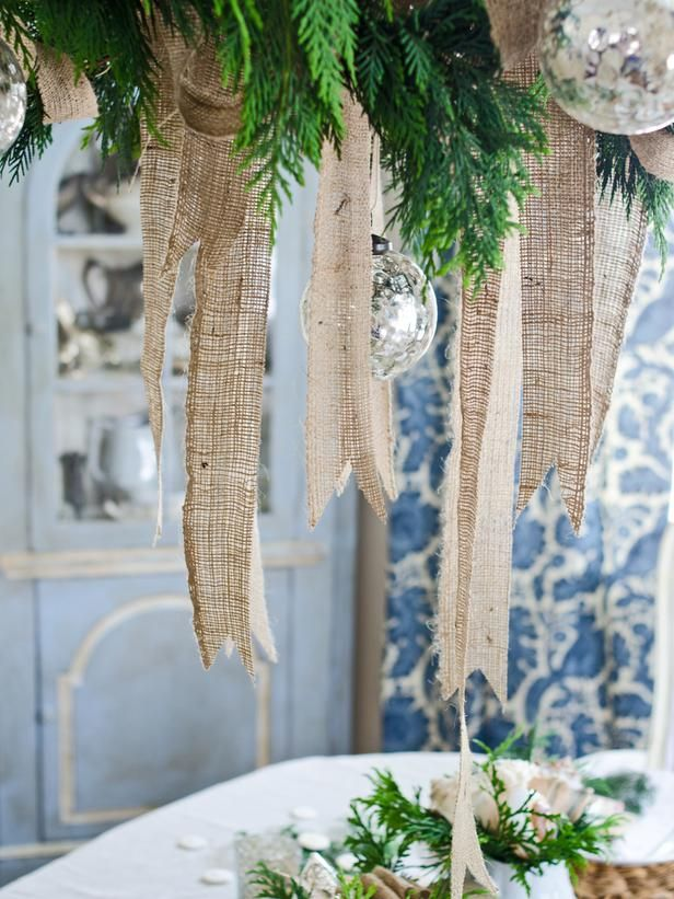 Dres up your chandelier with burlap and other nature-inspired items. Gorgeous! #hgtvholidays http://www.hgtv.com/entertaining/create-a-coastal-chic-holiday-table/pictures/page-8.html?soc=hpp