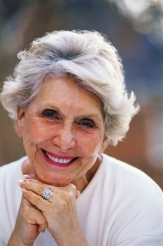 Short or medium hair length is suitable and makes the face look younger.