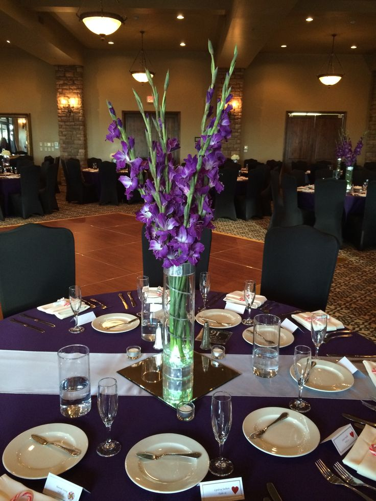 Purple gladiola centerpiece with silver accent