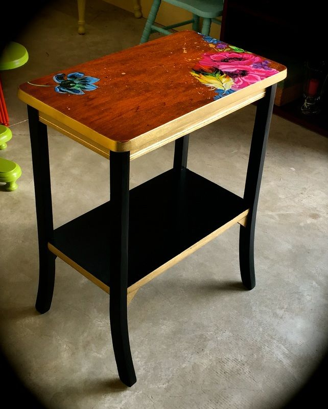 Black & gold end table with hand-painted design work.