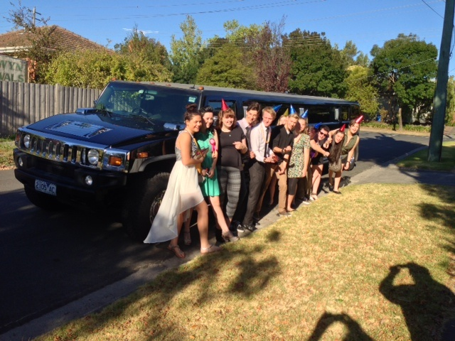 Group party photo next to our black hummer limousine :)