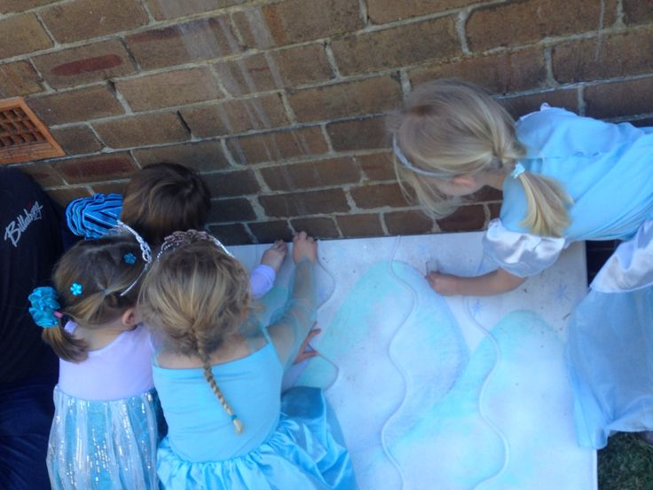 Girls racing ice cubes down the snowy mountain