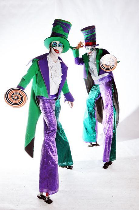 Vibrant purple & green ringmaster stilt walkers. Big Foot Events.