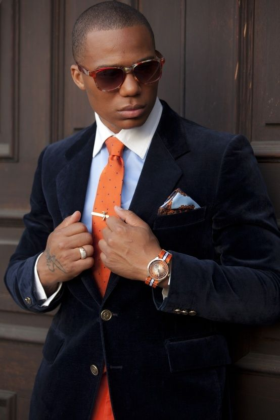 Shop this look for $268:  http://lookastic.com/men/looks/light-blue-dress-shirt-and-orange-tie-and-navy-blazer-and-light-blue-pocket-square/1749  — Light Blue Dress Shirt  — Orange Polka Dot Tie  — Navy Velvet Blazer  — Light Blue Floral Silk Pocket Square