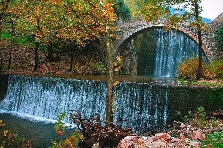 Waterfalls and ancient bridges at Epirus. Great mountain walk through the greek landscape.
