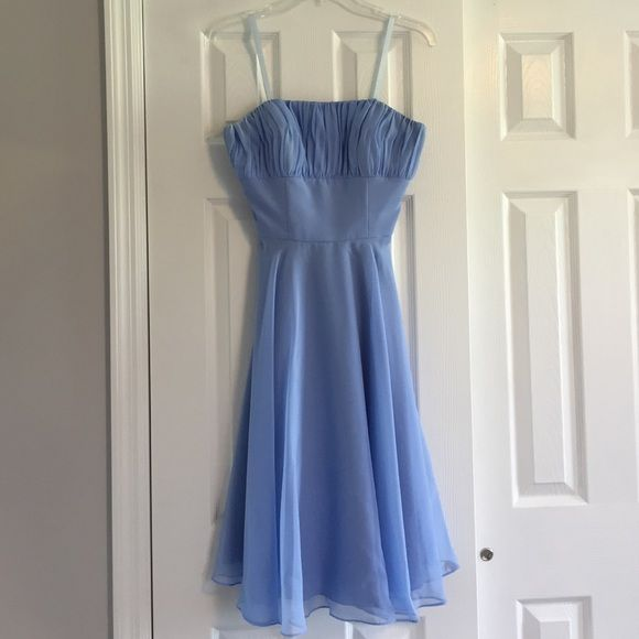 Mori Lee bridesmaid dress 735 in cornflower blue Strapless chiffon dress with zipper back. Vertical shirring overlays the empire bodice on the flared a-line dress with waist tie sash. This gown comes with a matching sash, an ivory sash and a black sash. Worn once to a formal. Mori Lee Dresses Strapless
