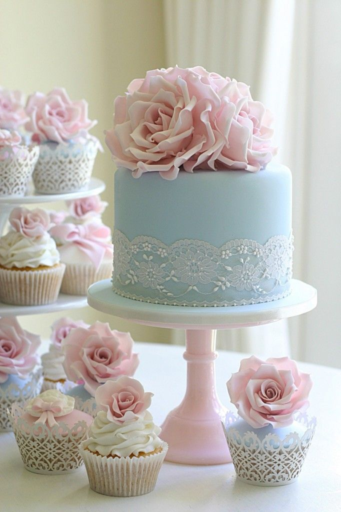 I like the idea of doing something different for a wedding cake. The cupcake idea is adorable!