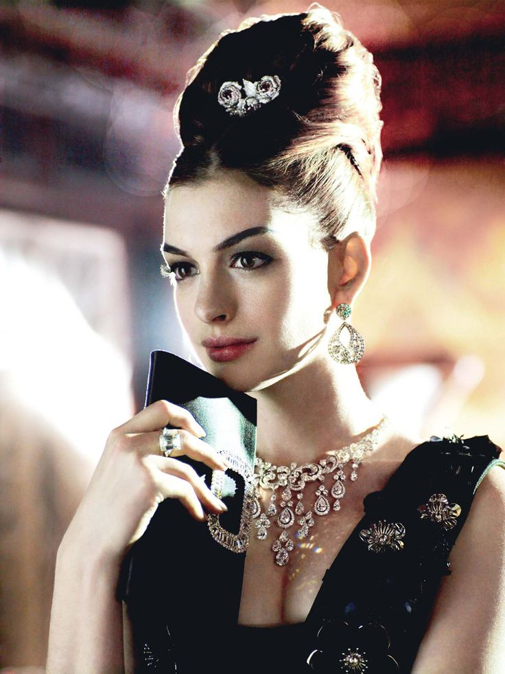Anne Hathaway does Breakfast At Tiffany's & she does it with such elegance...Great Hair...Awesome Pic!~Kimberly Robyn