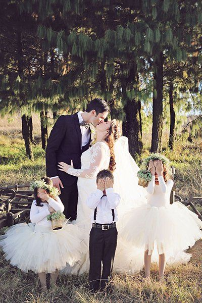 "Why We Love It: We love this cute photo with the flower girl and ring bearer!Why You Love It: ""Such a sweet moment!"" —Sarah P.Photo Credit:…"